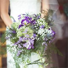 Natalie wanted her wedding flowers to be as natural looking as possible, as though they were handpicked. Shaw's of Amersham created the wedding bouquets from beautiful natural looking flowers in shades of purple and cream, with lots of pretty, delicate greenery to balance out the look.Flower arrangements also decorated the church, and in the reception venue, ivy was wrapped around candelabras and bird cages for a rustic look.