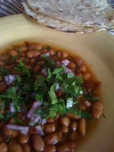 Frijoles.... my husband's fav, just beans with cilantro and onion on top:)