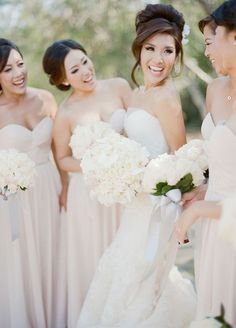 Sophisticated high bun updo wedding hairstyle; Featured Photographer: Sylvie Gil Photography
