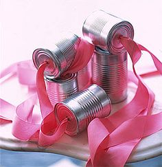 just married. spray paint a shiny silver. use thick ribbon. white