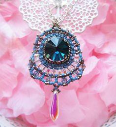 Handmade pendant made with miyuki beads, crystal and glass.