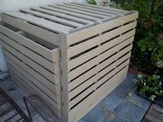 Air-conditioner cover made from 4 pallets, a few zip ties, and leftover fence paint.