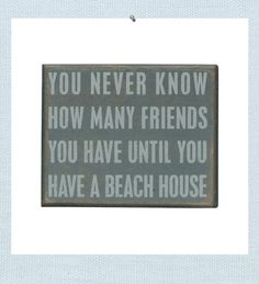 """Beach House Friends sign. """"You never know how many friends you have until you have a beach house"""". Weathered and rubbed wood creates beach wall art that looks aged from wind, sand and sun."""