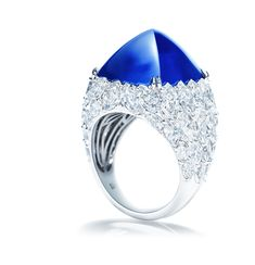 Harry Winston Sugarloaf Sapphire Ring.  1 cabochon sugarloaf sapphire 65.68 carats; 192 marquise, pear-shaped and round brilliant diamonds 7.26 carats.