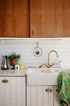 gold faucet and cabinet pulls / kitchen