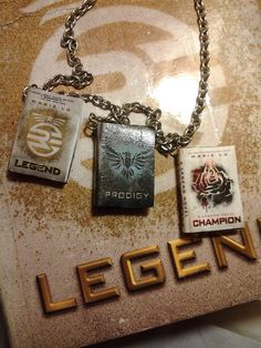 Legend Trilogy Book Necklace...I like kinda really need this! Keep that in mind for my birthday!