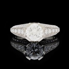 Platinum ring features a GIA 1.31 carat round brilliant cut diamond accented with 56 round brilliant diamonds totaling 0.79 carats.  Gorgeous diamond ring for that special someone.   CLICK PLAY ICON TO WATCH VIDEO