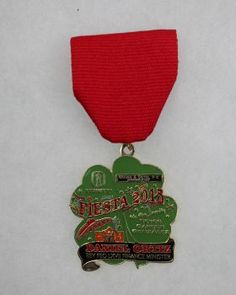 Rey Feo's finance minister Daniel Ortiz's medal depicts several San Antonio landmarks including the Alamo, the Tower of the Americas and his alma mater Trinity University. Photo: JUANITO M GARZA, San Antonio Express-News / San Antonio Express-News