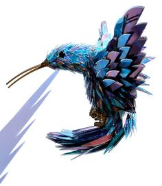 Shattered CD Sculptures: With shattered bits of old CDs, Sean Avery creates intricate sculptural animals, insects and birds, making fur and feathers from the shards.
