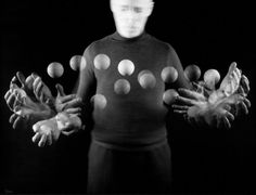 Stroboscopic image of juggler Stan Cavenaugh juggling balls.