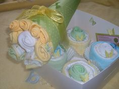Adorable washcloth cupcakes and flower bouquet by Sweet Diaper Cakes!