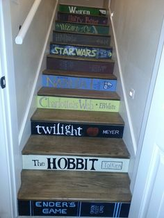 Stairs painted to look like book spines.