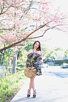 "For Love & Lemons Luciana Print Dress, BaubleBar Seaglass Bib necklace, Cult Gaia ""IT bag"" of the season, Sam Edelman lace up wedges, Molly Phillips tassel earrings"