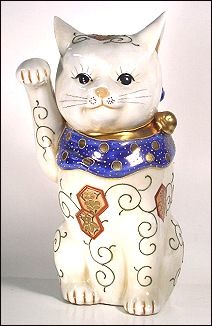"Vintage white porcelain Maneki Neko, covered with symbolic lucky ""turtle"" patterns"