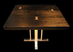 Black and Silver Table with Prism Criss-cross Pesdastal Base