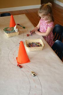Colorable table cloth - such a cute idea!  Could just use a flat sheet from Walmart  - they hold crayon well.