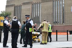 Police, paramedics and fire crews are seen outside the Tate Modern gallery in London on August 4, 2019 after it was put on lock down and evacuated after an incident involving a child falling from height and being airlifted to hospital. (Photo by Daniel SORABJI / AFP) (Photo credit should read DANIEL SORABJI/AFP/Getty Images)