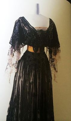 Image from Fashion History written by Akiko Fukai, The Kyoto Costume Institute, Taschen Publ. Jacques Doucet, Evening Dress, Label: Doucet 21. Rue La Paix Paris, c.1903. Black silk lace with bead embroidery and velvet; silk chiffon sleeves with inset lace belt of gold grosgrain ribbon.