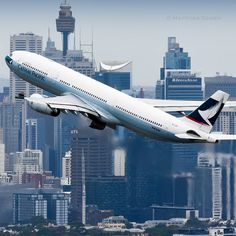 Cathay A330 in front of the Sydney Skyline