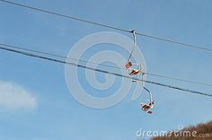 Two  cable cars against the blue sky during winter sports.