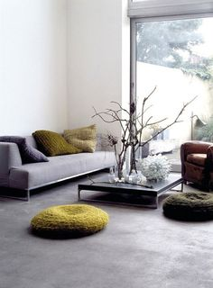 Polished concrete floors that melt smoothly into the rest of the room to create a cool yet warm feel to the room. The touches of woollen mustard bring a little vibrancy and comfort to the industrial feel.
