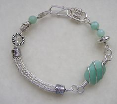 Viking knit bracelet. I love how the wire is wrapped around the rectangular bead.