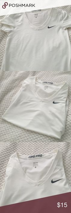 Nike Pro Slim -Tshirt All white Nike T-Shirt. The fabric is very tight and slimming so if you like that feel free :) Never Worn. Medium- Great for workouts to keep your sprouts bra in tact ☺️ Of course, no rips, stains or discoloring. Nike Tops Tees - Short Sleeve