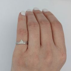 """Sometimes less is more, and nothing says that like a chic, minimal engagement ring set. This ring set has been designed with modern bride in mind, featuring a 14K solid gold bands and beautiful diamonds, This ring can be customized in a satin, hammered or polished finish. It's ideal for brides-to-be who love special, sweet jewelry but don't want to wear something overwhelming or """"loud"""". It possesses just the right amount of sparkle to illuminate your fingers and draw ooh's and aah's from…"""