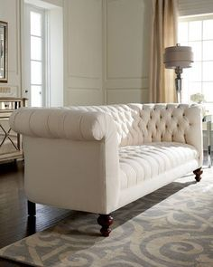 white Chesterfield sofa. Chesterfields are deep, tufted sofas with arms and back of the same height. This is actually an Old Hickory sofa and not exactly a Chesterfield, but it's a similar effect and would bring some country estate elegance to a contemporary room.