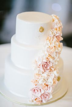 Peach cascading wedding cake. Photo by Origami Creatives