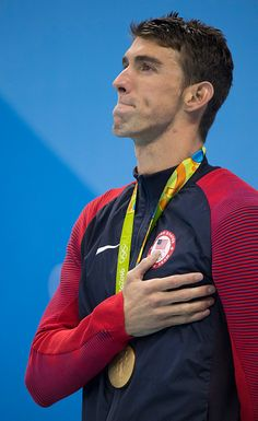 #RIO2016 Michael Phelps looks up at the US flag as it's raised during the medal ceremony where he was awarded his 22nd career Olympic gold medal after he won...