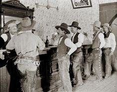 Cowboys at the bar in Old Tascosa, Texas, circa 1907.