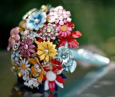 I don't want a broach bouquet for my wedding, but I think they are so fun! I want to make one.