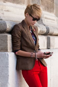 short hair, menswear, bright pants, tons of rings and bracelets and lets not forget... Ray Bans.