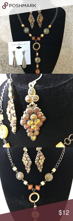 """2 For $12 sale-Earrings and necklace bundle. Earrings and necklace bundle contains one pair of Anne Klein earrings measuring 1-1/2"""" long. One pair of Amber-colored gemstone earrings measuring 2-1/2"""" long and an adjustable necklace measuring 16"""" with a dangling piece in the middle hanging down 3-1/2"""". Jewelry Earrings"""