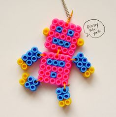 hama/perler beads or cross stitch design idea - love the articulated limbs - for a necklace or card Perler Bead Designs, Hama Beads Design, Diy Perler Beads, Perler Bead Art, Pearler Beads, Melty Bead Patterns, Pearler Bead Patterns, Beading Patterns, Art Patterns