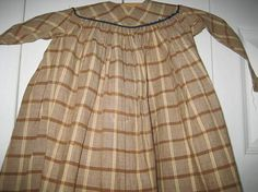 EARLY-BROWN-AND-WHITE-DOLL-S-DRESS