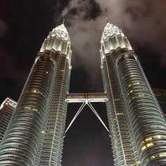 """P E T R O N A S  T O W E R S 🌏  Did you know that the towers are depicted through its outline, which resembles the letter """"M"""" for Malaysia. The jagged outline subtly resembles one of Malaysia's famous traditional handicrafts – basket weaving – thus highlighting her strong cultural values.  The triangle that symbolises the skybridge acts like a fulcrum that perfectly balances Malaysia's past and future, local values and global outlook and multi-cultural background. With an upward-pointing…"""