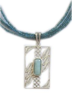Sterling silver rectangle Larimar pendant. www.larimoon.com