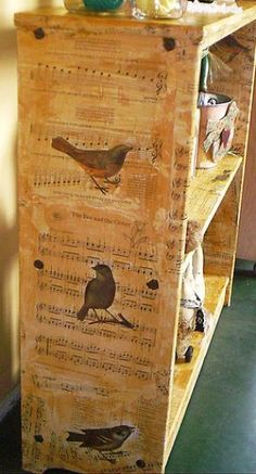 Piano Music and birds decoupaged onto junk bookshelf and antiqued with a wash - pinned to decoupage + furniture boards - by JUNKMARKET Style - #decoupage #bookshelf #DIY #crafts - tå√