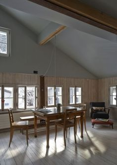Sunlit dining area at Halbhaus, a Swiss chalet remodel by architect Jonathan Tuckey | Remodelista