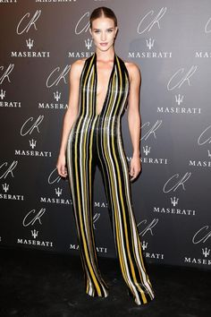 Rosie Huntington-Whiteley in  stripes jumpsuits. silhouettetrend.com
