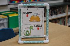 Frogs in First: Make your own little anchor chart stands to hold important charts from reading or writing workshop.  They're a great way for kids to have to access to the charts, especially older charts you're no longer displaying in the classroom.