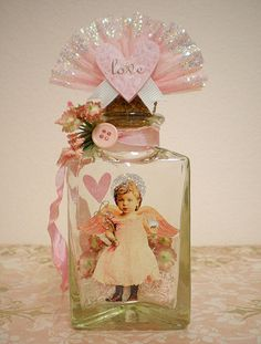 Fairy altered bottle and more altered bottles Check out the website to see Perfumes Vintage, Vintage Bottles, Vintage Valentines, Valentine Crafts, Jar Crafts, Bottle Crafts, Bottles And Jars, Perfume Bottles, Glass Bottles