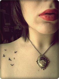 Necklace and tiny tats.