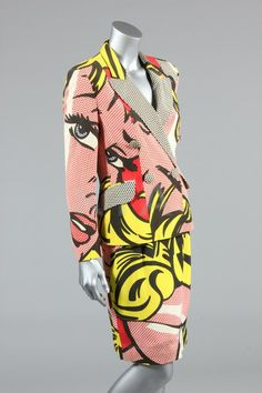 A Moschino Lichtenstein print pop-art suit, 1991, Cheap & Chic labelled and GB size 10, with overall outsized newspaper print, lined in satin printed 'Primavera Estate 1991 Collection, No 6 Low Estimate: 400 High Estimate: 600gbp