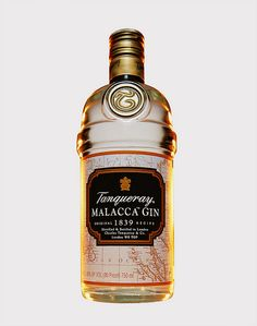 """Tanqueray Malacca Gin - """"Old Tom"""" style which is wetter; The taste is robust but smooth. Citrus up front again, a tad bit of acidic tang. Lemon, and Grapefruit. The middle we get some baking spices, Cinnamon in the middle. The finish is perhaps the shining moment for this gin, you get a tad bit of juniper and a long creamy finish with notes of creme anglaise, specifically warm creamy vanilla, cinnamon, nutmeg and clove."""