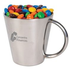 Promotional M&Ms In Promotional Stainless Steel Coffee Mug. 250 grams of milk chocolate M&M's packed in coffee mug. M&M's available assorted colours only. Allergen advisory label on base of Coffee Mug. M & M Chocolate, Stainless Steel Coffee Mugs, Personalized Chocolate, Branded Gifts, Confectionery, Thank You Gifts, New Product, Promotion, Milk