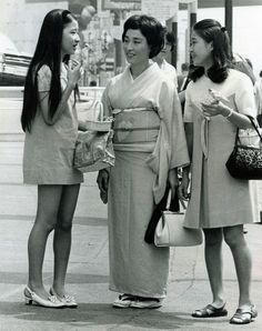 """Japan's Two Worlds – Minis and Concealing Kimono"" Press Photo dated Dec 16, 1968."