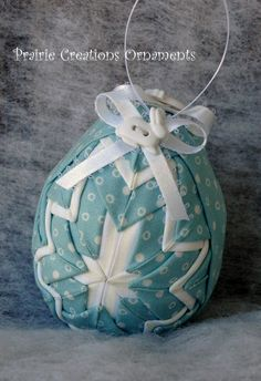 This adorable Easter Egg ornament is made from a pretty aqua blue with white circles fabric and accented with white fabric. It is topped with white ribbon bows and a cute white bunny button attached on each side.  All my ornaments are my own original designs and made individually with great care to detail.  Be sure & check out my other ornament designs at: http://www.etsy.com/shop/myprairiecreations.